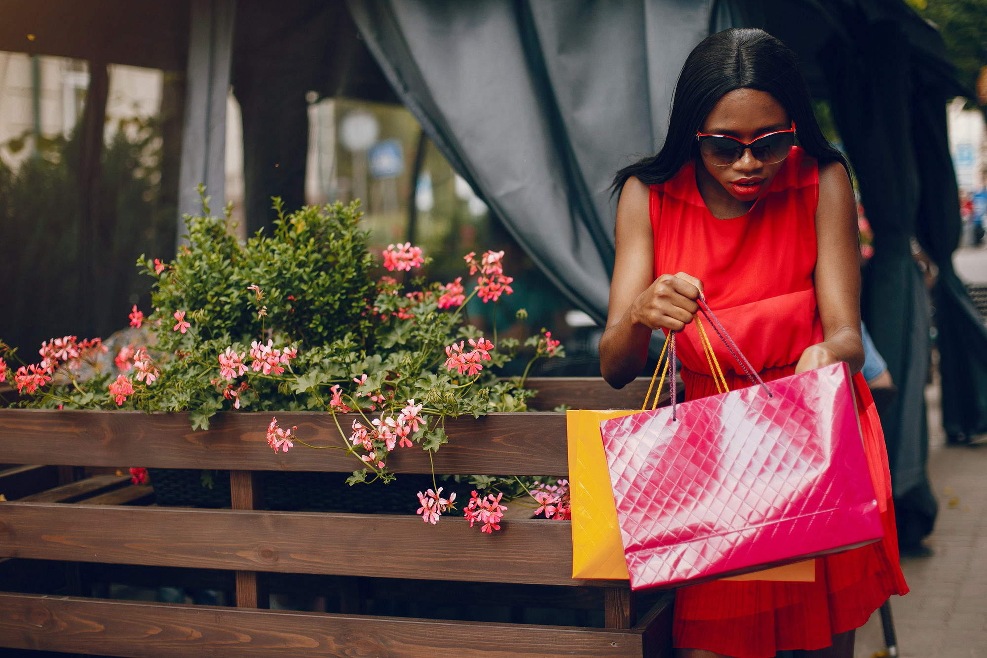 Beautiful black girl with shopping bags in a city