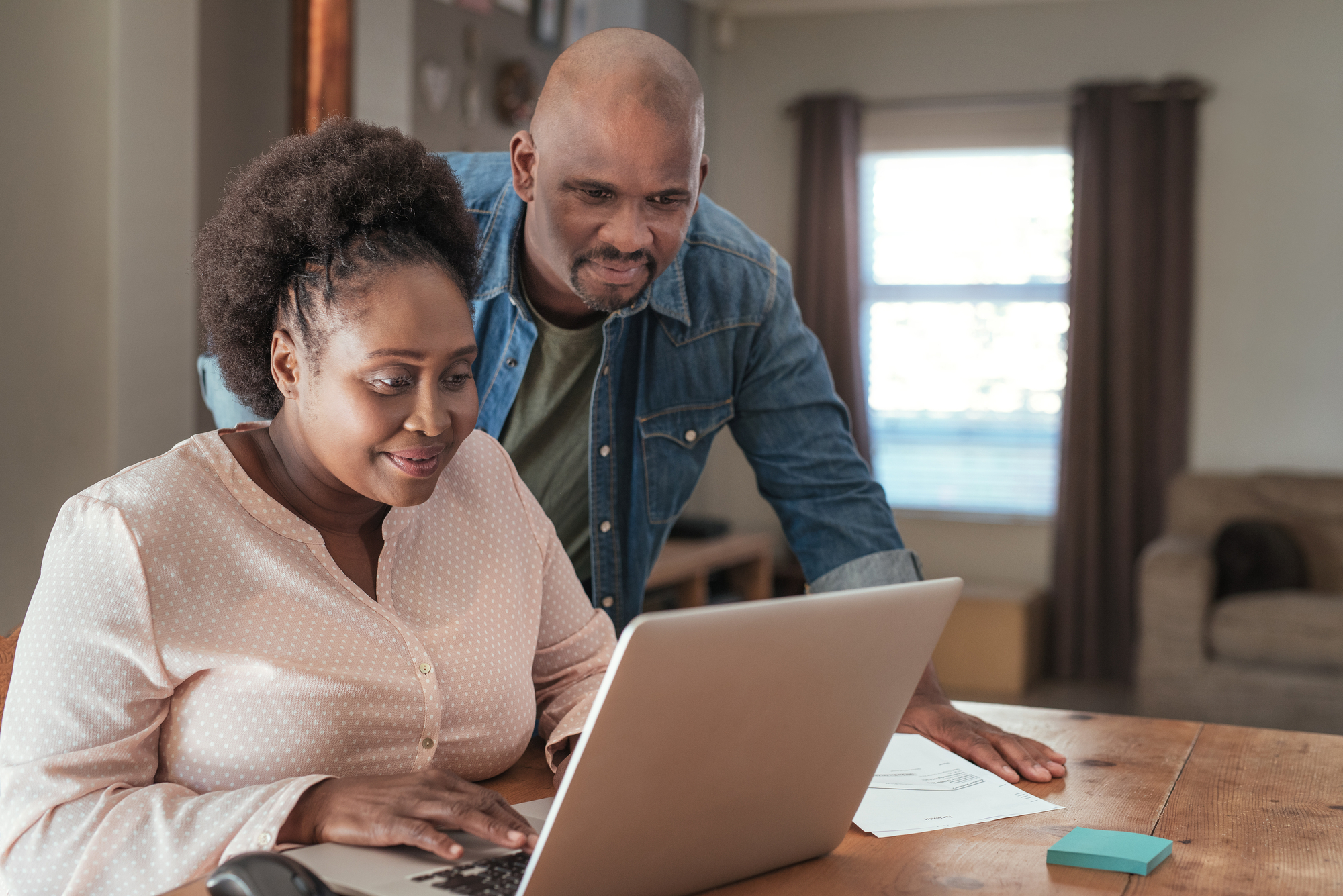 Couple paying bills with laptop