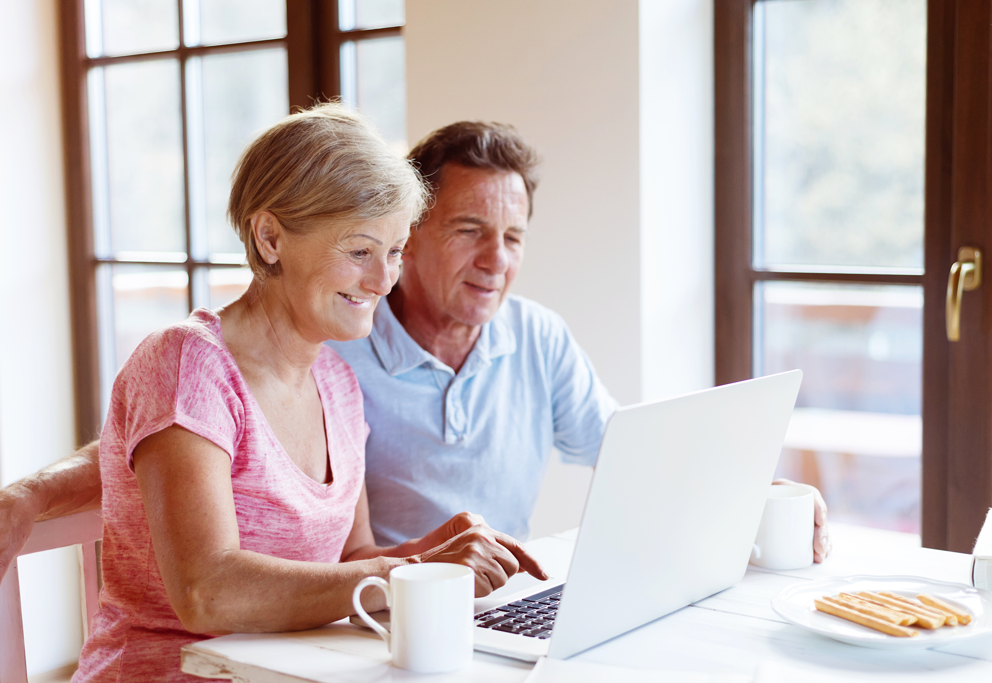 Senior couple working on laptop