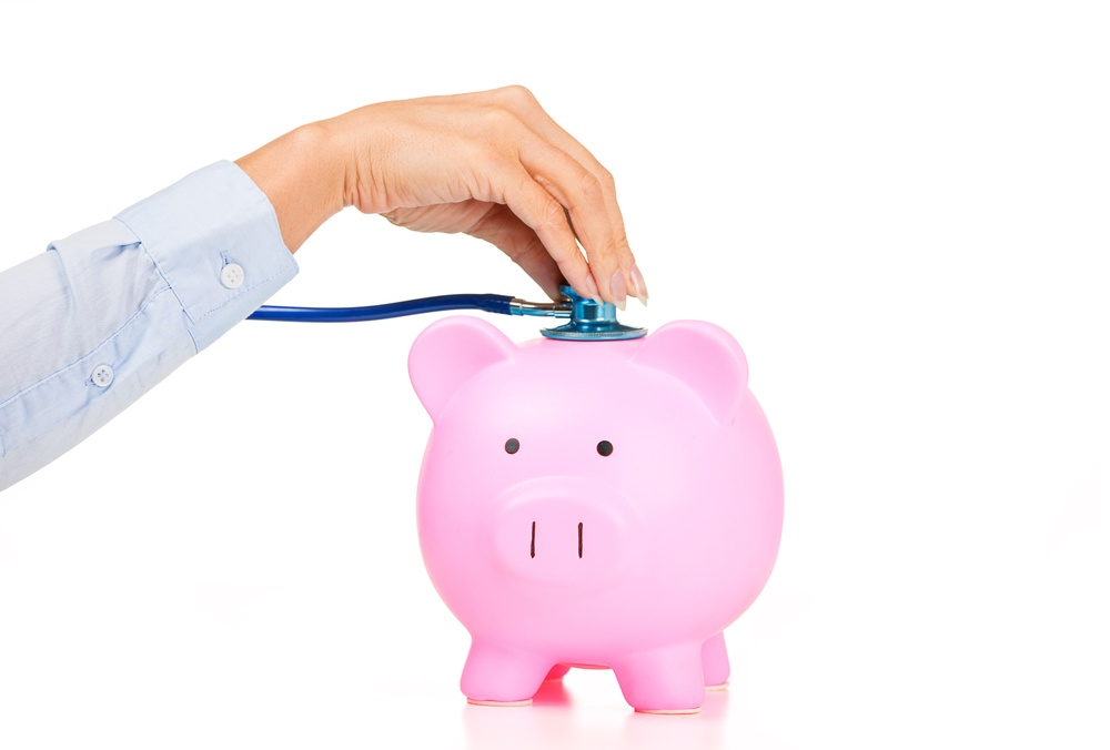 Woman hand stethoscope pink piggy bank Isolated on white background. Health care cost. Financial state condition self assessment concept. Financial system checkup, savings for medical insurance costs